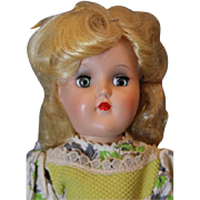 "1950's  Vintage Hard Plastic Toni Doll, 14"" tall. Original blond hair in Original Set, Original Tagged dress, nylon socks, black plastic shoes. Excellent, Unplayed with condition!!"