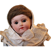 "German bisque head doll, 5 1/2"" tall, all original clothes and in great condition, no damage or repairs. Marked Germany, 390, 15/0. original mohair wig and clothes."