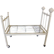 "Vintage painted metal doll bed with bed spring.  Beige in color, wheels on bottom, can be dismantled for shipping. 3 pounds in weight. Sturdy doll bed. 20 1/2"" long X 17 1/4"" tall X 11 1/2"" wide in size."