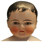 """11"""" tall Handsome boy, known as Frozen Charlie, German bathing toy! Made of All china with black molded hair."""