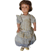 "Sleep Eyes on this Miss Dolly Schoenhut doll! 1920's doll, Rarer version! brown sleep eyes, brown human hair wig, Possible original dress, Tip of Nose flake. 17"" tall in size."