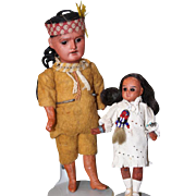 German Bisque head Indian dolls. Father and daughter. Made by Recknagel, marked R.A. on the father. No mark on the daughter.  glass eyes. Native American dolls.