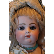 "15 1/2"" tall F.G. Block Letter Gaultier Bebe with closed mouth, molded tongue, Jumeau marked body and nice antique sock and pale blue leather boots, nice mohair wig and silk dress & bonnet."
