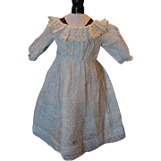 """White antique doll dress, completely lined with cotton, dotted swiss fabric and antique lace trim. Should fit a  20-21"""" china, parian, or any other doll with a lovely chest area to show off!"""