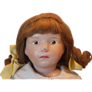 "Great Schoenhut doll with original human hair wig, pouty face! original paint on face, nose rub flake off of tip of nose and small crack on cheek area, next to nose. 16"" tall, hard to find face!!"