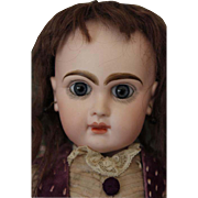 "15 1/2"" tall Beautiful Tete Jumeau, with no hairlines, breaks or repairs to the bisque head, Large blue glass eyes, long painted eyelashes on top and bottom, Great old purple silk dress, old leather shoes! FAB!!"