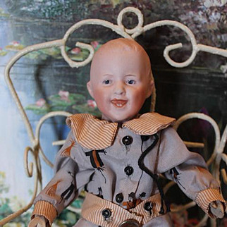 """Smiling Heubach character body doll, Clapper Doll! 8 1/2"""" long in size! Bisque antique German doll head, wood hands and composition legs. Works great!"""