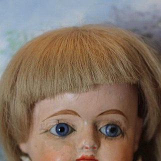 """20"""" Papier Mache doll, with original blond human hair wig, nice pink dress with old pantaloons, blue glass eyes. compo lower arms and lower legs with painted shoes and socks. Straw stuffed body."""