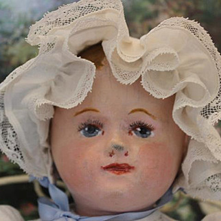"""Small sized Martha Chase oil painted baby doll! nose rub on face, painted hair, nice old baby gown with bonnet. 15 1/2"""" long in size."""