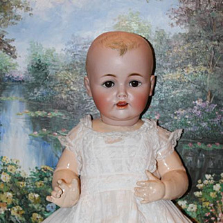 """Large Antique German Baby Jean doll! 25"""" long, with no hairlines. Kestner doll. Bisque head with brush stroke painted molded hair. Long Beautiful antique gown and lace  bonnet"""