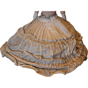 "Vintage Hoop skirt slip for your doll! Tie string in the back, some staining on the gathers. For a smaller doll. Doll is 11"" tall and is a model only.  Gathered Rayon fabric. Vintage  antique doll slip."
