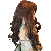 "Dark Brown human hair, machine wefted doll wig, for a  12-13"" doll head. Dark brown, almost black in color! No bangs, long curls, used wig. French Cheveux wig, size 8 inside wig."