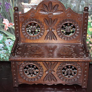 French Breton wood carved bench. Great for your dolls to sit and be displayed on! 2 missing spindles on the back of the bench.  Solid wood from France!
