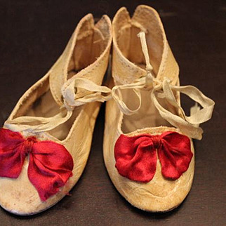 """Leather doll shoes for a large foot. Measures 3 1/8"""" long X 1 5/8"""" wide in size, with fushcia  pink ribbon bows."""