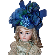 "Vintage womens hat in royal blue and emerald green colors. Great for dolls too. Shown on a 12 1/2"" head circumference and a 16"" head circumference head.  Very dramatic!! Perfect for dolls!"