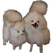 Pair of dogs, one is German Spitz dog, the other one is an unknown maker of dog, but made of straw like material. Glass eyes on both dogs! Spitz dog has 1 shorter leg than the other legs.