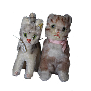 "Pair of Steiff cats, both have the silver pin in the ears, the white one cat has  the yellow steiff tag in the ear, larger one is 7 1/2"" tall and the smaller one is 7"" tall in size."