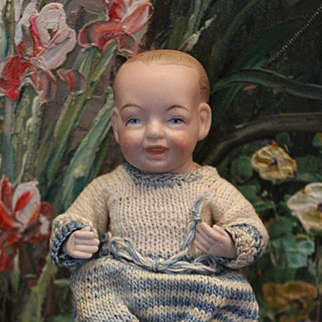 """Adorable antique all bisque baby boy, unknown maker, marked 230, 14. almost 6"""" long in size, can sit, needs restringing on legs. replaced legs and arms. Painted features."""