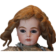 Blond human hair doll wig, size 8 inside the wig, long curls, no glue residue.
