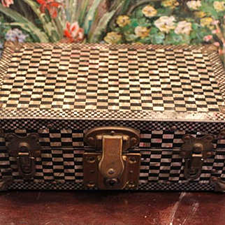 "Metal American made wood doll trunk,  faux Mother of Pearl  look. Black and white trunk, no key, original paper lining inside. 9 3/4""X5 1/2""x 4"" tall."