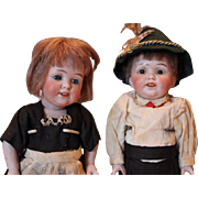 Cutest pair of German antique all Bisque dolls, swivel neck, original matching clothes,  damage on one hand on each doll.