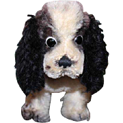 "Steiff mohair Cocker Spaniel dog in black and white, red collar and part of the metal Steiff pin in ear. 9"" long X 7"" tall in size. Great condition!"
