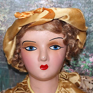 """Nice condition on this Boudoir Bed doll, from the 1930's.Papier Mache shoulderhead, arms and lower legs. Nose rub, original dress. 28"""" Long."""