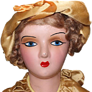 "Nice condition on this Boudoir Bed doll, from the 1930's.Papier Mache shoulderhead, arms and lower legs. Nose rub, original dress. 28"" Long. - Red Tag Sale Item"