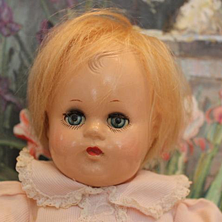 """Vintage Madame Alexander, Baby Bitsy in original pink costume, blond mohair over the composition head. 11"""" tall in size."""