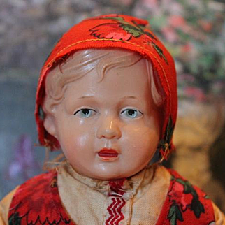 """10 1/2"""" tall Old German Celluloid doll. In original costume. No shoes. 1950's era or older."""