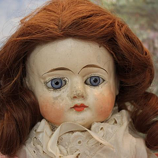 """20"""" tall Papier mache doll with new wig, blue glass eyes, old clothes. damage on tips on shoes. underclothes, slip, pantaloons."""