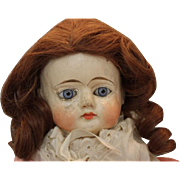 "20"" tall Papier mache doll with new wig, blue glass eyes, old clothes. damage on tips on shoes. underclothes, slip, pantaloons."