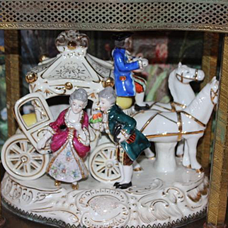 German Victorian Porcelain Horses & Carriage Figurine with Metal Gazebo. It also lights up, old plug. Weighs 8.3 pounds in weight. Large figurine!