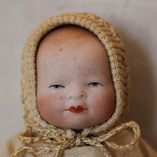 """Grace Story Putnam Tiny 4"""" long All Bisque baby with stamp on chest. Repair at crotch area. Sweet little size antique baby."""