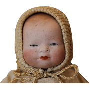 "Grace Story Putnam Tiny 4"" long All Bisque baby with stamp on chest. Repair at crotch area. Sweet little size antique baby."