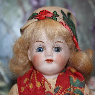 "7 3/4"" tall Bisque Head German Kling doll in original costume. Marked 123 on the back. Sleep eyes. Shoulderhead, original mohair wig,"