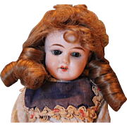 """Marked 1902 on this antique German doll, beautiful  face, 11 1/2"""" tall, no hairlines. Original clothes, cotton. compo body, human hair wig."""