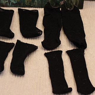 4 pairs of black doll socks. For antique, vintage or new dolls. Netting, cotton socks, largest pair is not antique. doll clothes.