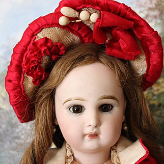 """Pretty 16 1/2"""" tall French Antique Tete Jumeau, couture red and cream silk dress with matching silk bonnet! No hairlines, breaks or repairs!"""