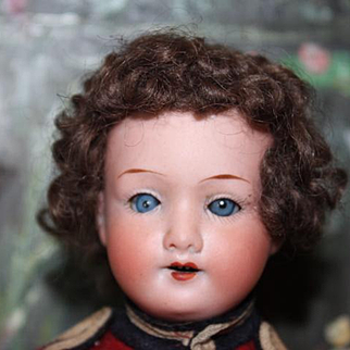 "Armand Marseille, A.M. German antique Soldier doll, boy doll in uniform, missing one shoe. 9"" tall, original costume. German bisque head, composition body."