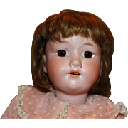 """20"""" tall Armand Marseille doll. mohair wig, pink dress, brown set eyes. German Antique doll, German bisque head. Composition body."""