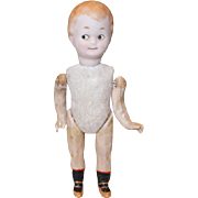 "Googly type doll, 6 1/2"" tall, bisque head, painted eyes, composition arms, legs and body, painted shoes & socks, Unknown maker."