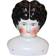 "4 1/2 X 4"" German China head only. 1890's, no body, molded curls, center part Black hair, blue eyes, #4 on back. white  spots on back of head, no hairlines or repairs."