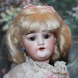 "Sweetness! 10 1/4"" tall, Heinrich Handwerck German Antique doll, bisque head, composition body, brown sleep eyes, mohair wig, pierced ears, 1 earring on. Sweet dress!"