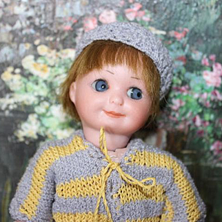 """Armand Marseille Antique German Bisque head, composition body, Googly ,#253 mold number, set blue eyes, crochet outfit, human hair wig. Adorable! 7"""" tall."""