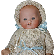 """Sweet Armand Marseille A.M. Baby, bisque head, sleep eyes, compo arms & legs, Papier Mache body. 8.5"""" in size. Knitted baby gown. bonnet & socks, diaper."""
