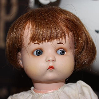 """9 1/2"""" tall German Armand Marseille Just Me bisque head doll and composition body. Blue sleep eyes. Marked body. Original paint over the bisque."""