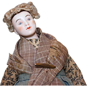 """Unusual Dressel and Kister China head doll, bisque hands, china head, wired stuffed body. 11 1/2"""" tall. damage on lower leg. - Red Tag Sale Item"""
