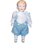 "5 1/2"" tall All Bisque Antique Boy doll, painted hair, face and molded socks, painted blue  shoes. Chunky body, tiny factory chip on one toe. can't see it."