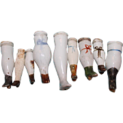 9 Single antique China head legs, doll repair, or replacement legs for your China head dolls. No matched pairs.
